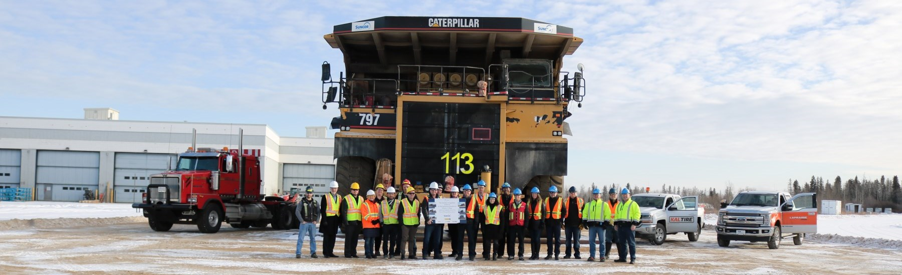 supporters standing in front of donated haul truck