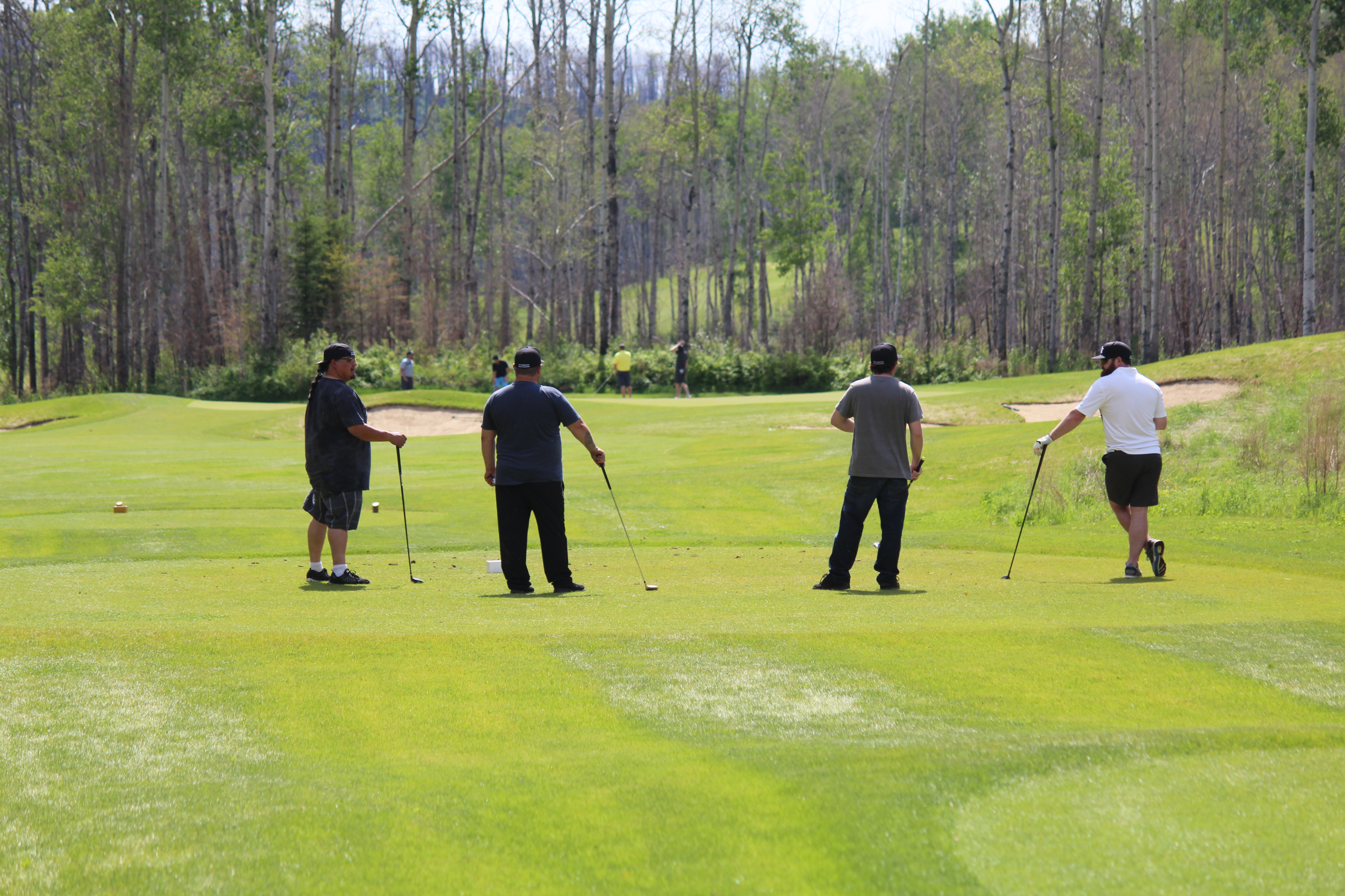 golfers wait at tee off